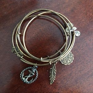 4 Alex and Ani Bracelets - 3 with charm 1 plain